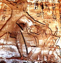 Ramesses despatching three Sea People warriors