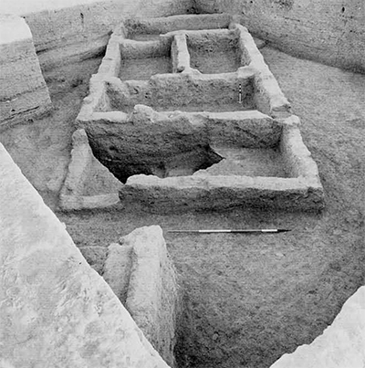 Between 6500 and 6000 B.C. Tell Abu Hureyra relied on a mixed economy with agriculture supple�mented by hunting. Tell Abu Hureyra is settled at this period and the small initial colony soon expands into a large village covering 11.5 hectares (28.5 acres). The mud-brick houses are clustered tightly together around courtyards and narrow lanes. The houses are facing south and south�west to catch the winter sun, a habit which has persisted in present modern villages of the area. The walls are thin suggesting that the structures were single-storied. They are made of rectangular bricks of various sizes. The plan of the houses includes a series of rooms, as many as five in some instances. The various rooms were separated by parti�tions which could include a rectangular port�hole doorway. The houses were faced with mud plaster sometimes protected by a white wash. They were entered by a high sill and a mud-brick linteled doorway (University of Pennsylvania Museum of Archaeology and Anthropology).